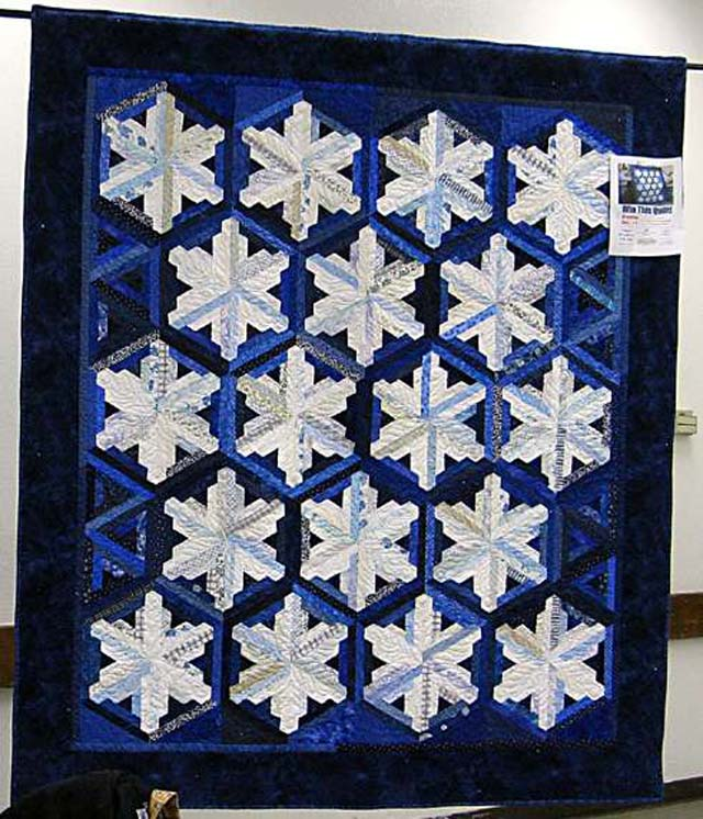 Not Your  Grandmother's Log Cabin page, 108 - Ice Crystals by Holly C. and the  Valley Quilt Guild