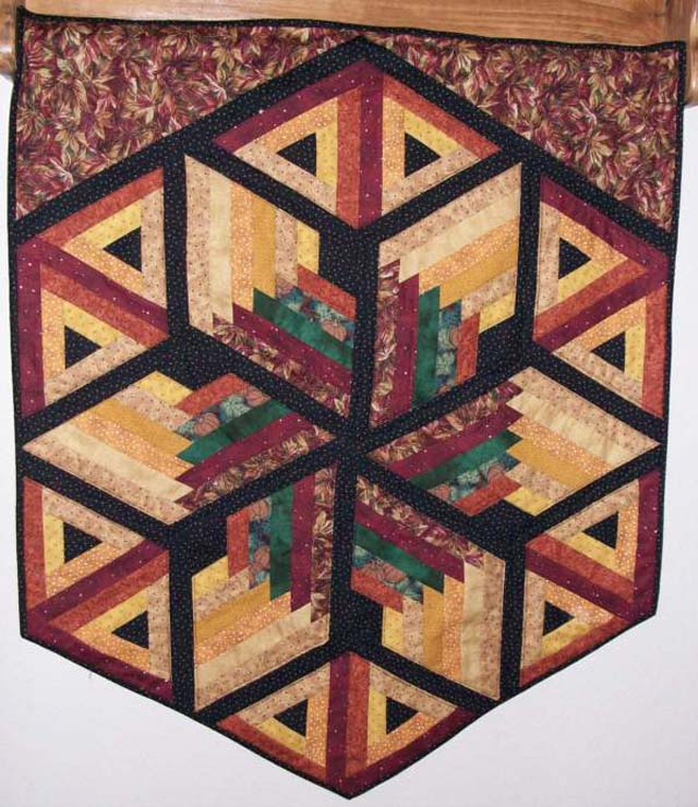 Found in Not Your Grandmother's Log Cabin, page 57 - Wall Hanging by Judy M.