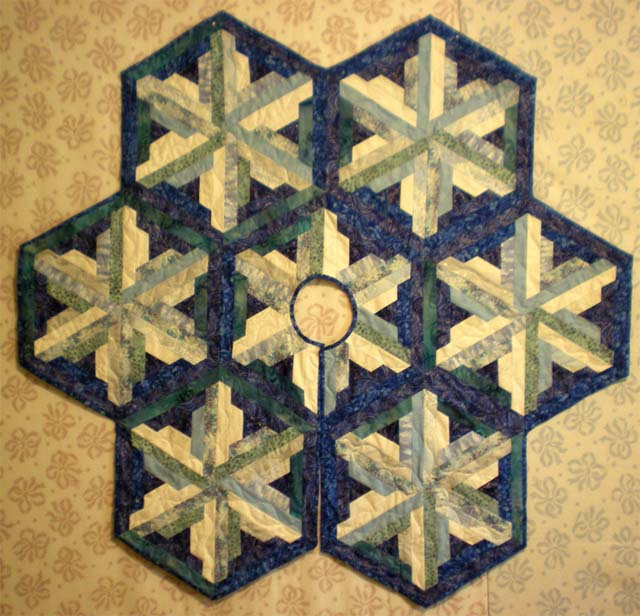 Found in Not Your Grandmother's Log Cabin,  page 108 - Winter Snow Tree Skirt by Diane R.