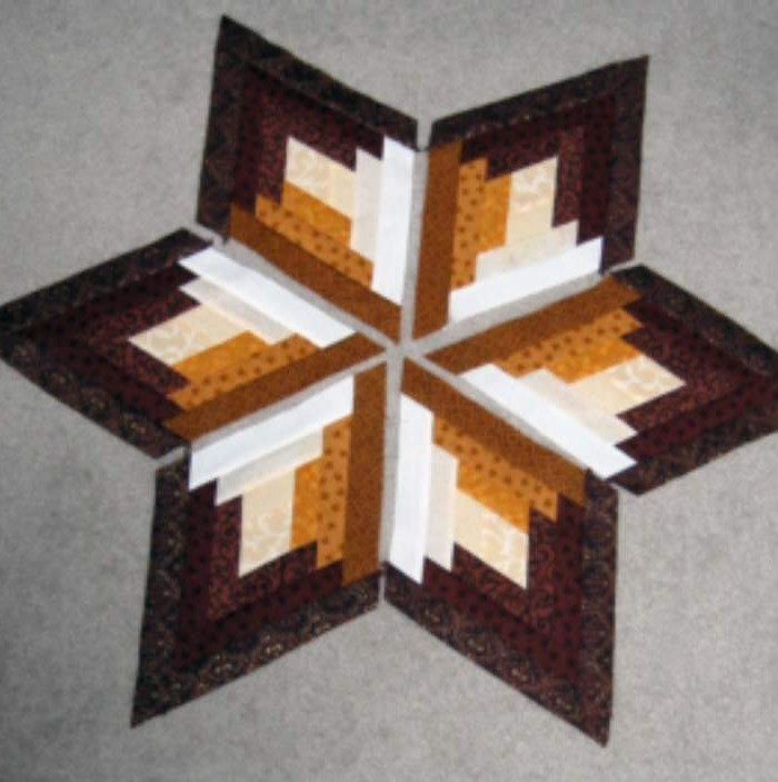 Found in Not Your Grandmother's Log Cabin, page 52 - Dragon's Claw (Japanese Star) by Donna A. - Pueblo, CO