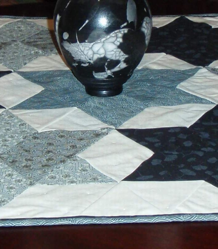 Found in Oh My Stars!, page 71 - Seven Sisters Table Topper by Kathy